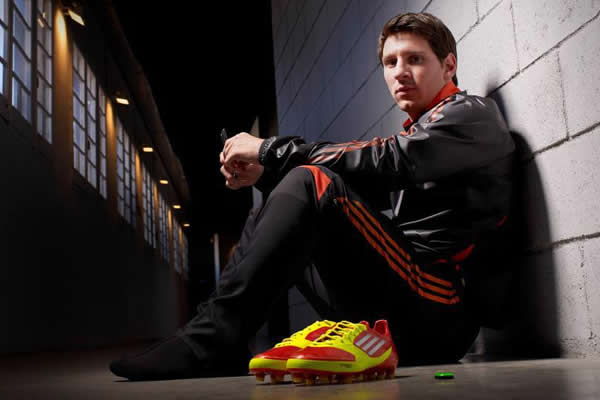 Lionel Messi with adizero micoach